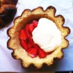 Layer cream, strawberries and wine inside brioche shell.